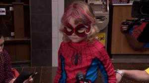 SpiderMable meets the media and fills them in on her mission to catch Mysterio