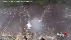 Hurricane Florence: U.S. Coast Guard swimmer investigates abandoned truck in North Carolina floodwaters (01:59)