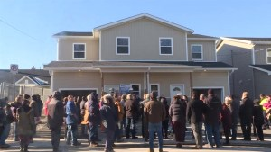 Two families move into new homes with help from Habitat for Humanity Kingston