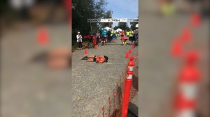 Marathoner collapses 11 metres from finish, rolls across to qualify for Boston