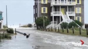 Hurricane Florence: Water seen rushing into coastal Carolina town as flooding commences