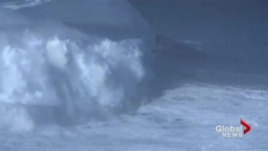 Surfer tackles the ultimate wave