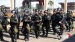 U.S. border protection agents stage drills as they await migrant caravan