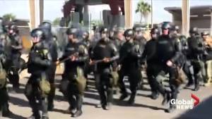 U.S. border protection agents stage drills as they await migrant caravan (01:09)