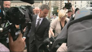 Cameraman bowled over in media crush as Nigel Wright arrives at court