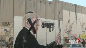 Palestinians remove Trump's mural from Bethlehem's barrier