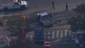 Demolished truck surrounded by New York City police after vehicle struck several people