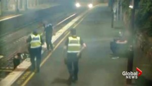 Australian woman escapes being hit be train in last-second rescue