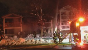 The investigation into a destructive fire at a Kelowna condo complex fire is on hold because of safety concerns
