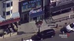 Aerial view of Greektown shows police tape across the scene of a mass shooting on Danforth