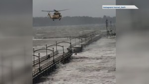 Chopper rescue of man off White Rock pier during storm