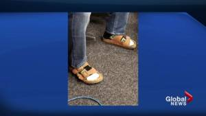 Jeff gets ripped for wearing socks and sandals