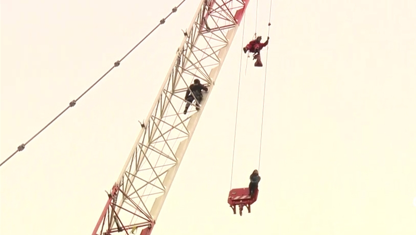 Woman rescued from downtown construction crane gets absolute discharge