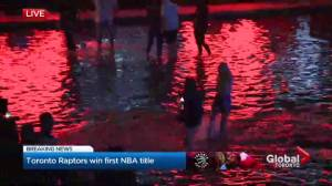 NBA Finals: Fans take a dip outside Toronto city hall celebrating NBA title
