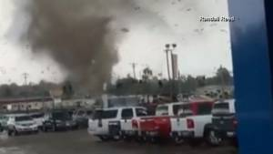Large tornado ripping through buildings caught on camera
