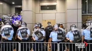 Protesters shine lasers at police in Mong Kok