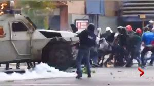 Police in Venezuela drive toward crowd of protesters with armoured vehicle