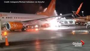 Pearson Airport worker films Sunwing plane on fire after clipping WestJet plane