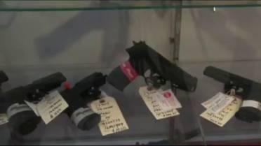Two men arrested, loaded handgun seized after alleged