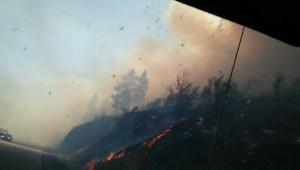 Fast-moving fire near Rock Creek strands residents