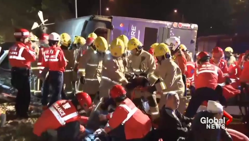 Hong Kong bus overturns killing 18