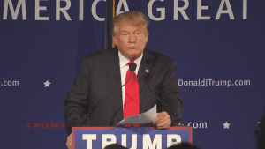 Donald Trump reads out his policy to ban all Muslims from entering the U.S.