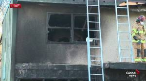 2 people hospitalized after fire at Holyrood rental complex
