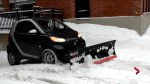 Smart car plowing snow in Saint-Henri