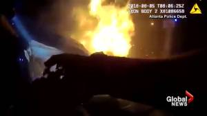 Dramatic footage shows good Samaritans and police rescuing passengers from burning car