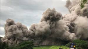 Ash cloud from Guatemala's Fuego volcano rumbles down onto golf course