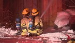 Calgary fire crews fight extreme cold weather to battle house blaze