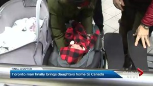 Canadian surrogate father brings twin girls home