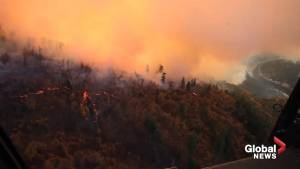 Black Hawk helicopter drops water on Camp Fire in northern California