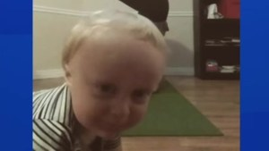 Toddler photobombs yoga mom's headstand