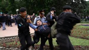 Dozens of Kazakhstan election day protesters detained by police