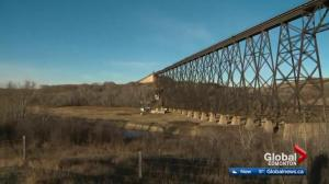 13 train cars derail off CN trestle bridge near Wainwright
