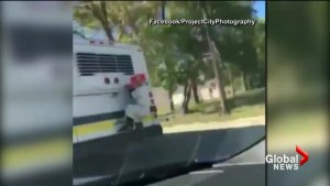 Video of 'creepy clown' hanging onto back of bus leaves Detroit commuters frightened