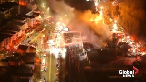Massive fire engulfs Boston casket warehouse