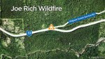 Residents evacuate fast moving Joe Rich wildfire