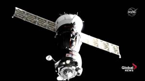 Soyuz spacecraft carrying new crew docks at International Space Station