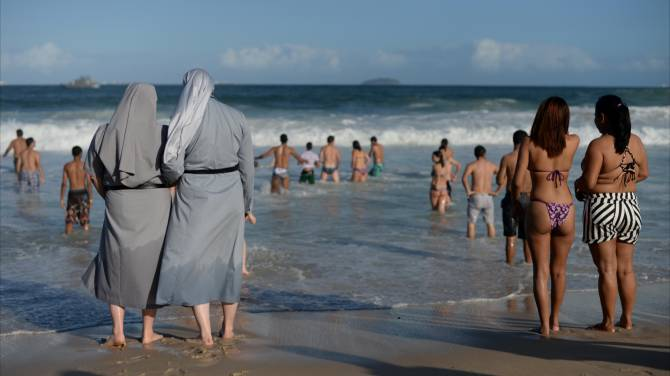 People share photos of nuns on the beach in response to ...