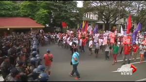 Filipinos in Manila protest against a Trump presidency on inauguration day