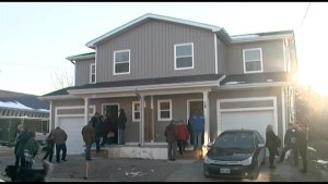 Two families receive keys to their new homes with Habitat for Humanity's help