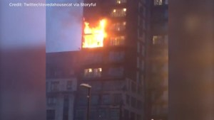 Firefighters tackle blaze at Manchester apartment building in England