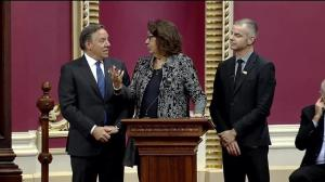 Iberville MNA Claire Samson shares a moment with Francois Legault while being sworn into the National Assembly