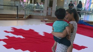 Calgary woman crochets huge Canadian flag as tribute to adopted country: 'A very joyful moment!'