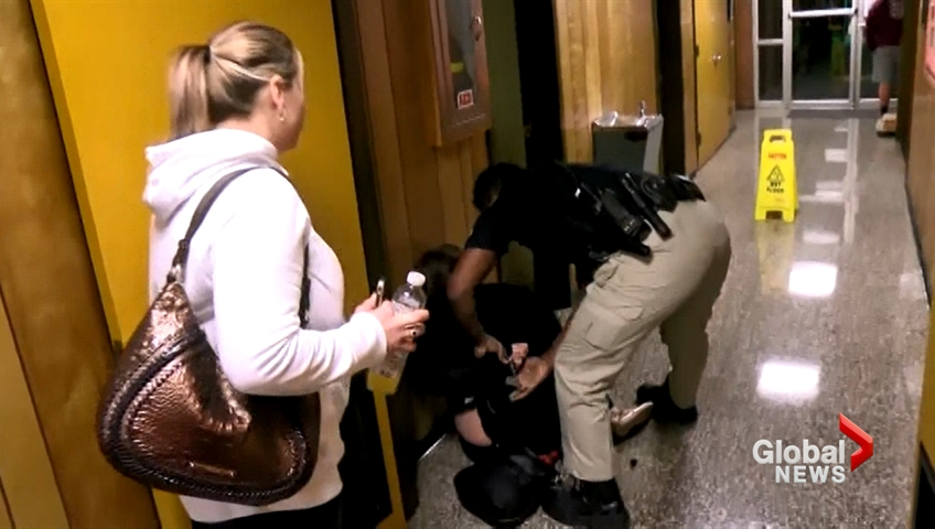 Teacher removed from school board meeting in handcuffs