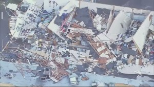 Storm damage team assessing tornado aftermath west of Seattle