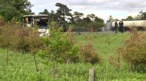 Multiple injuries after tourist bus crashes into ditch on Hwy. 401 near Prescott (01:03)