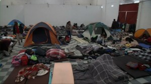 Some migrants move to new shelter as overcrowding sparks health fears in Tijuana